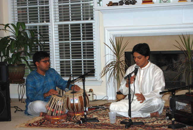 Adwait Joshi performing at a student recital of SwarGanga School of Music